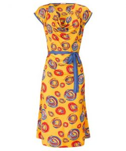 Mustard dress with red and blue circular patters and blue belt